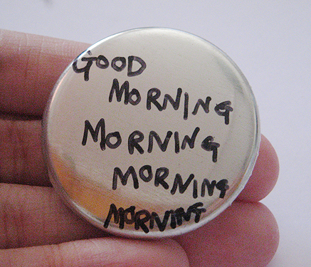 Handwritten GOOD MORNING MORNING badge